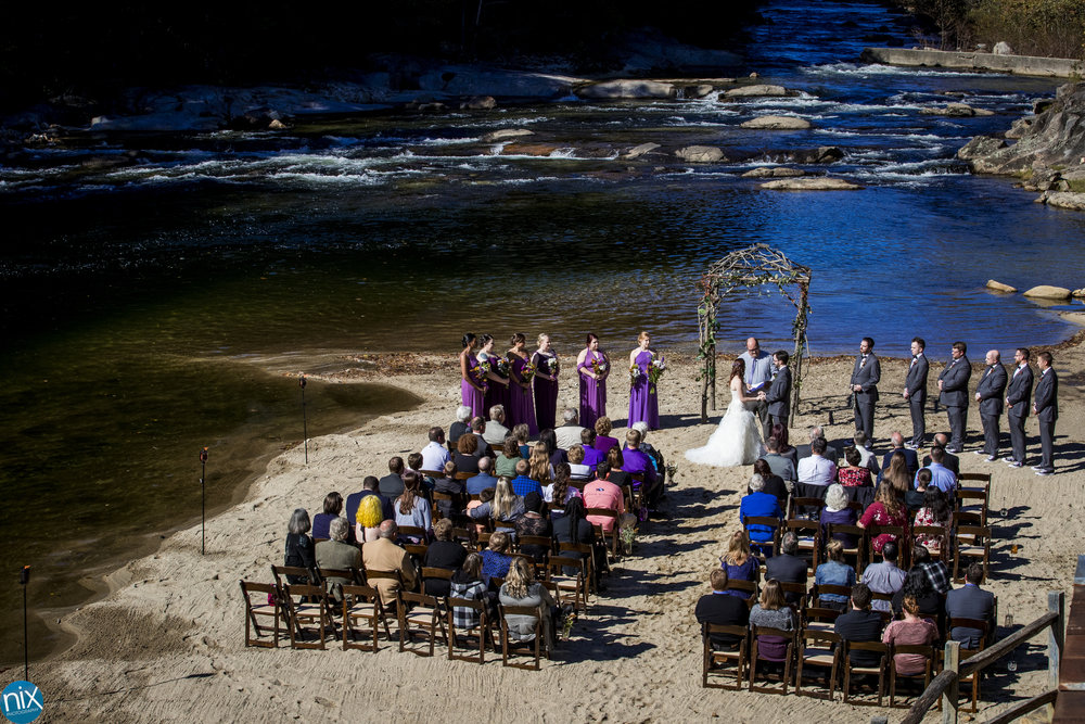 bride and groom exchange vows at Brown Mountain Beach Resort.jpg