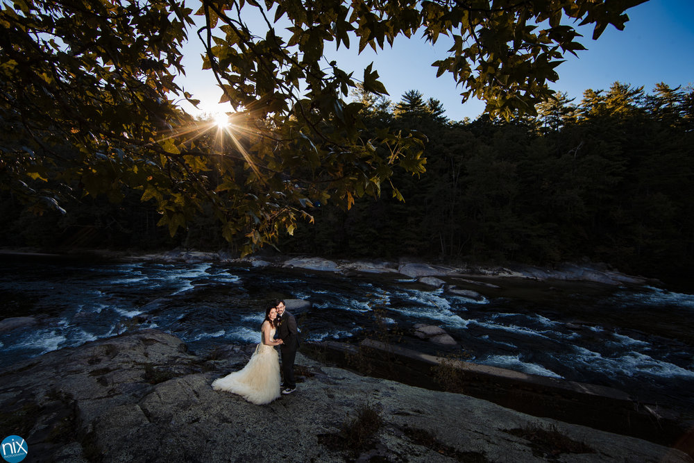 bride and groom with river in the background.jpg