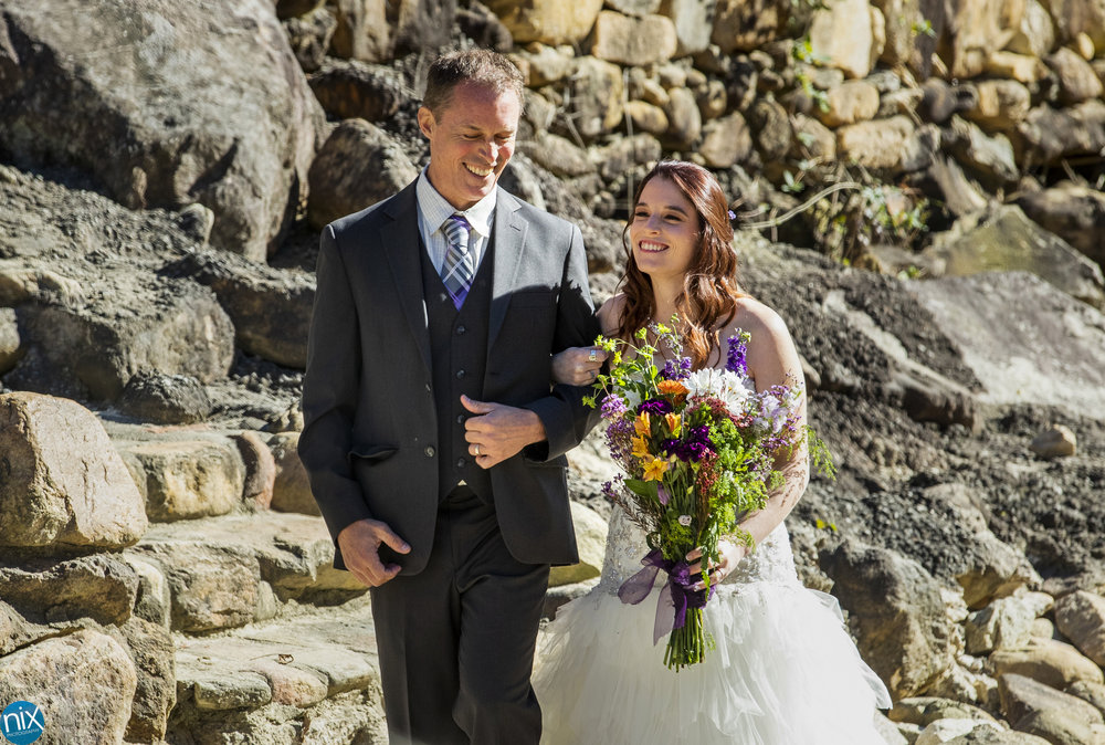 father walks daughter down aisle at Brown Mountain Beach Resort.jpg