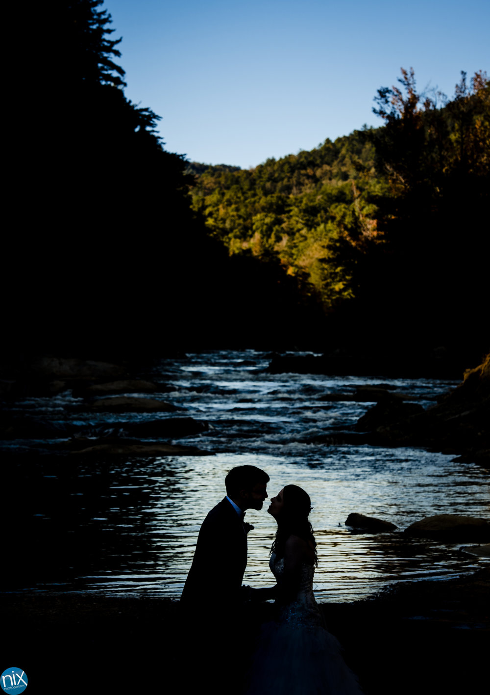 silhouette or bride and groom at Brown Mountain Beach Resort.jpg