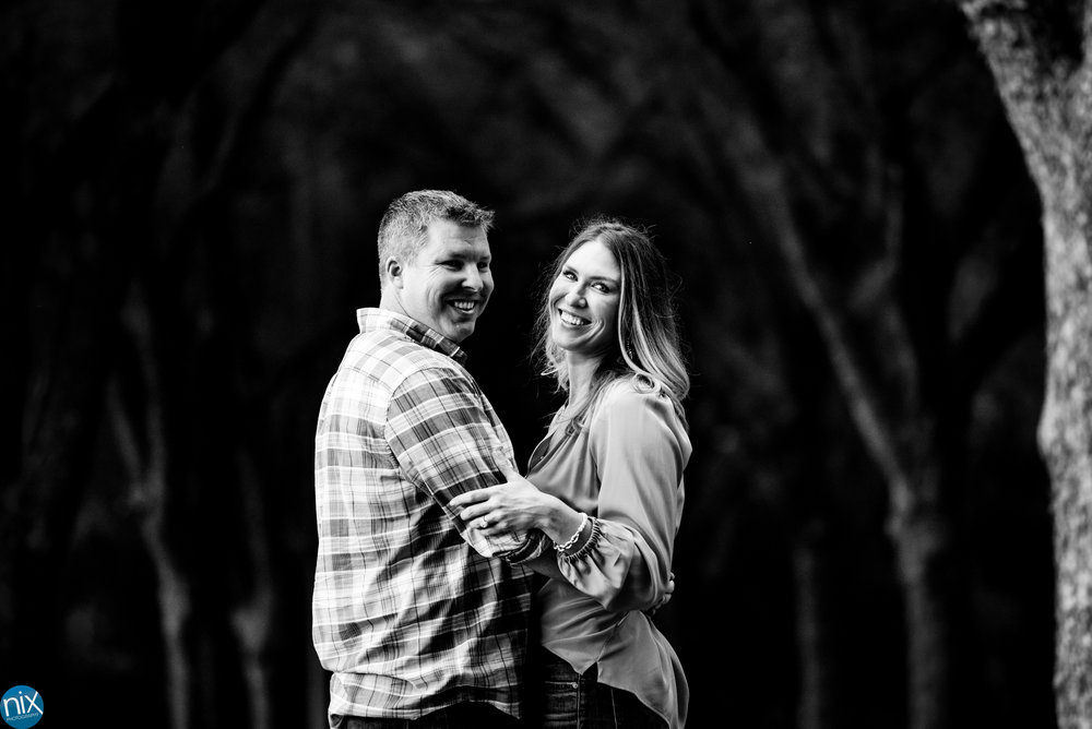 charlotte engagement photos in wooded area black and white.jpg