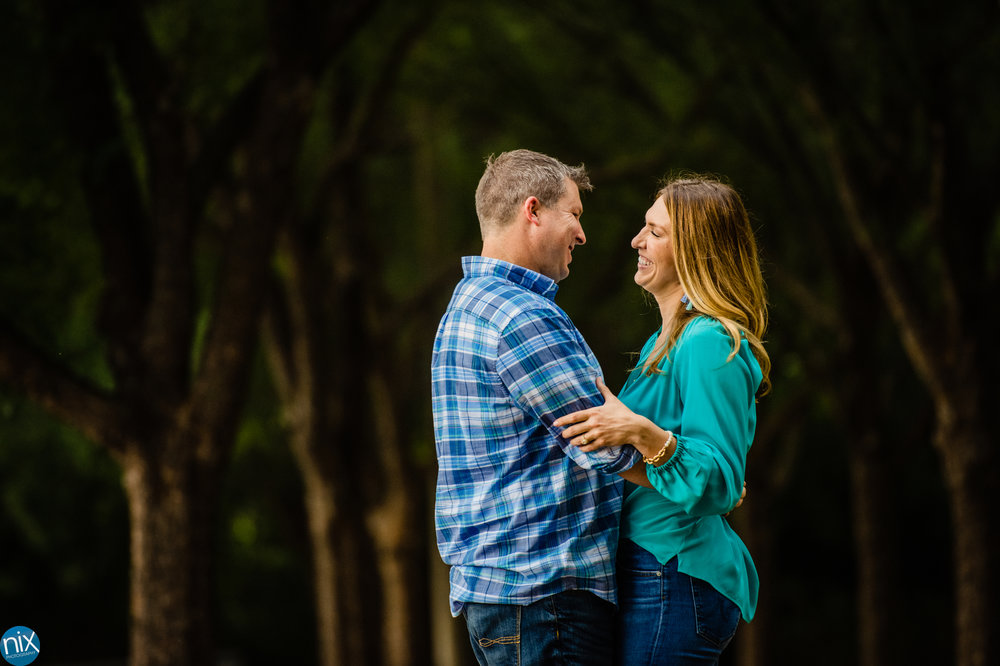 charlotte engagement photos in wooded area.jpg