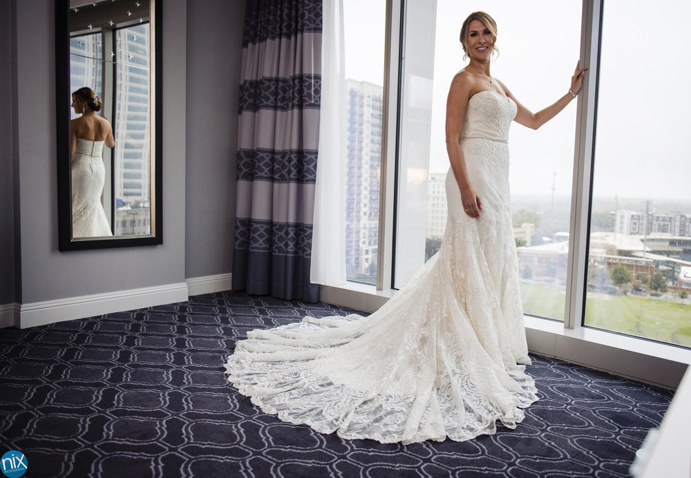 bride before a wedding at Kimpton Tryon Park Hotel in Charlotte.jpg