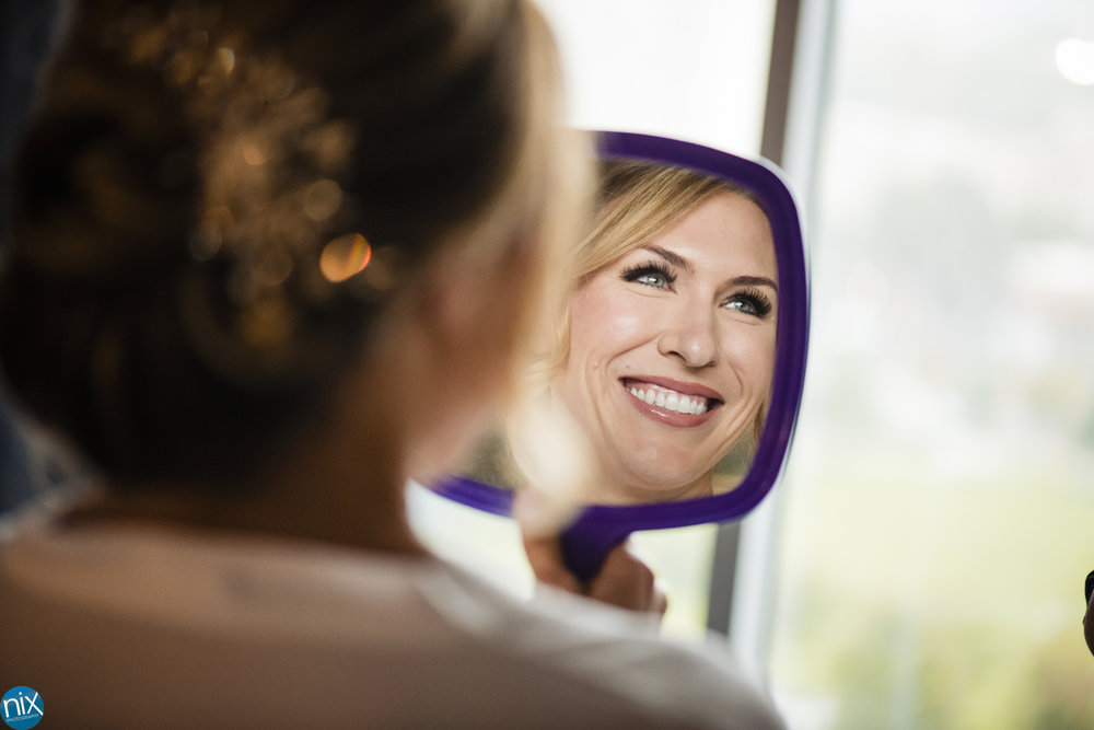 bride gets ready for wedding at Kimpton Tryon Park Hotel in Charlotte.jpg