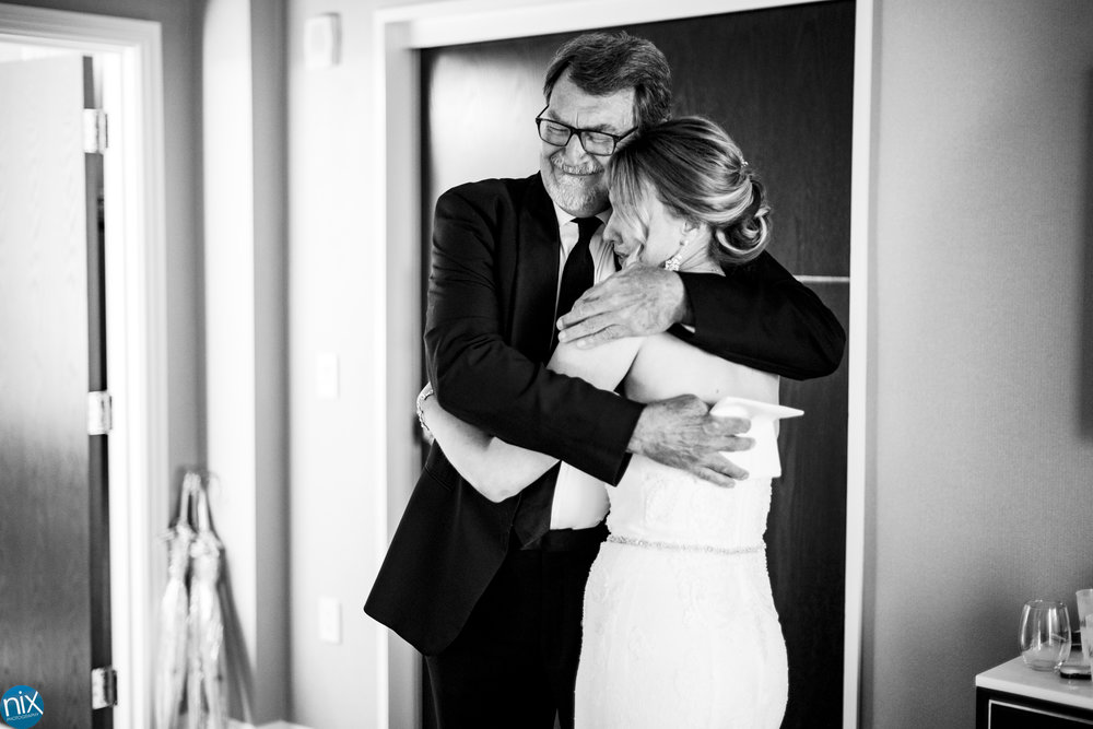 father hug daughter before her wedding at Kimpton Tryon Park Hotel in Charlotte.jpg