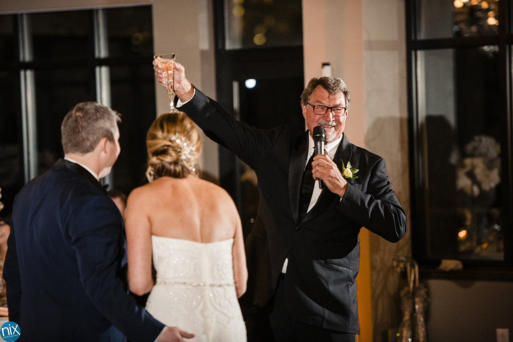 father toasts bride and groom during wedding reception at the Terrace at Cedar Hill.jpg