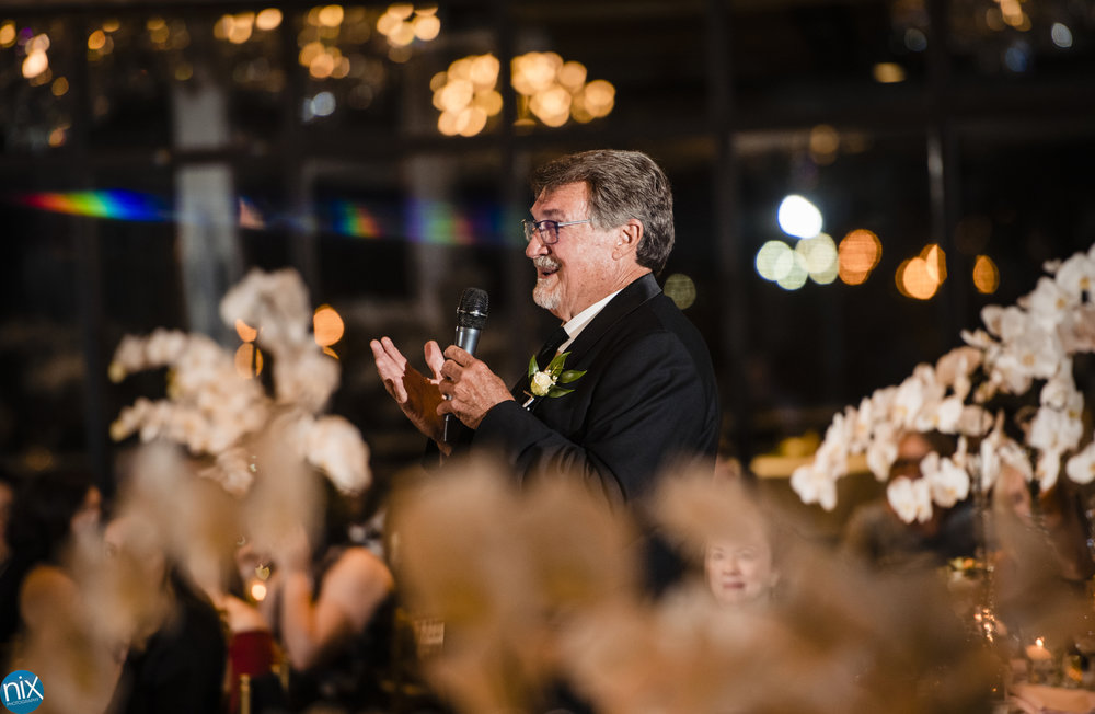 father toasts couple during wedding reception at the Terrace at Cedar Hill.jpg