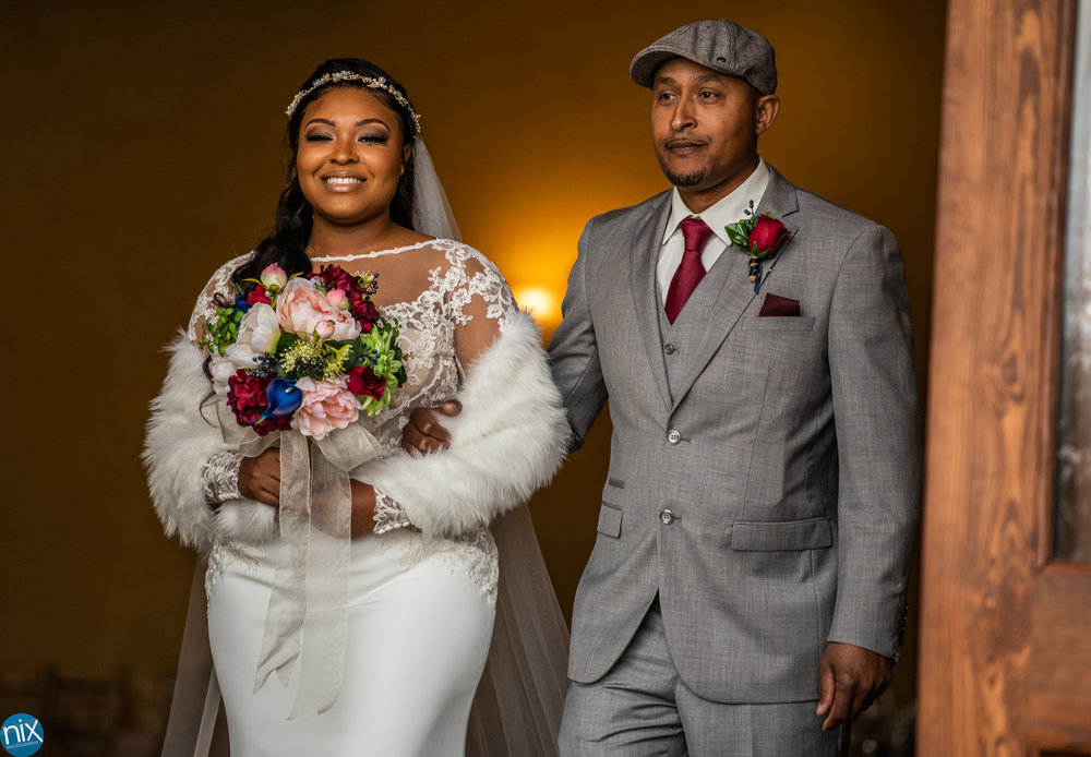 bride and father prepare to walk down the aisle at Tuscan Ridge.jpg