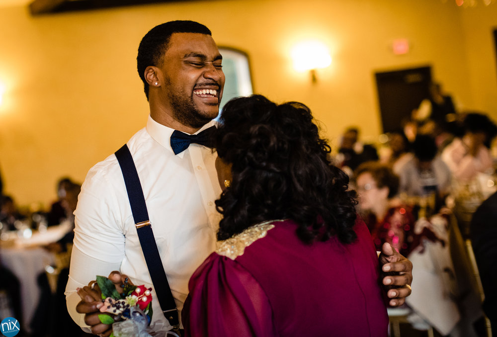 groom laughs while dancing with mother during Tuscan Ridge Wedding.jpg