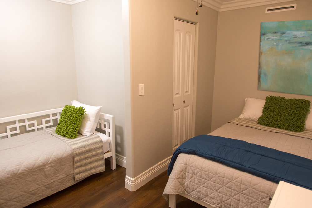 Second room furnished with two beds