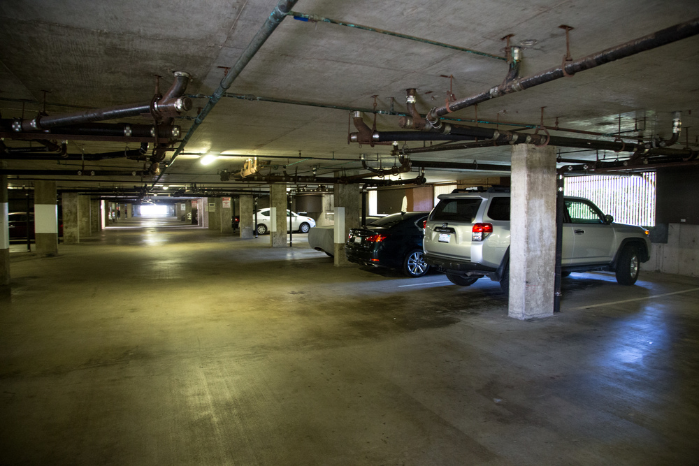 Two covered, garage parking spaces