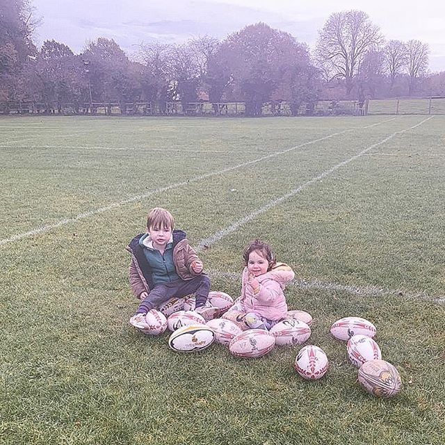 """Lincoln and Fleur sitting on ALL the rugby balls at Teddy's rugby training... just because 😏. . How often do you do things 'just because'?! We tend to always need a why, reason and justification as to why we do the things we do, why we feel the way we feel, why we make certain decisions. But WHY? Why as people can't we do a whole lot more just because? . Well, we can. And I encourage you to do just this - next time you do something just do it because you want to do it. Don't feel like you need to explain yourself... if you feel the need to answer simply say """"just because"""". It'll feel quite liberating 😏 and in fact open up a pathway to doing a whole lot more just because you fancy it and it feels good. What other reasons except that should we have anyway?! . So Lincoln and Fleur fancied sitting on those rugby balls, and they sat there for as long as they could before each one started being taken away to be used. I for one wasn't going to ruin their fun and at no point did I ask why, and as young children they felt no inclination to justify their actions... interesting right?! 😏. . So what are YOU going to do just because? 😍. . . . . . #motherhoodrising #motherhoodunited #motherhoodinspired #femalecoach #bloggingmom  #mummyvlogger #mumsofinstagram #channelmum #mumlife #mumblog #mumcommunity #motherhoodthroughinstagram #mumsofinstagram #motherhoodunplugged #babiesofinstagram #toddlersofinstagram #mumblogger #instamum #instamom #mumlife #momlife #mummyblogger #mommyblogger #Aquietstyle #motherofboys #motherofthree #secondtimemom"""