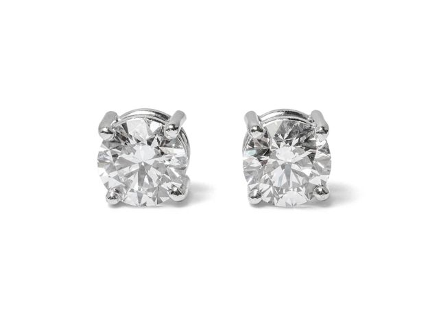 Four-claw-set Diamond studs in white gold.
