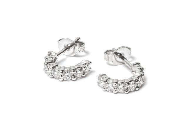 Claw-set half-hoop style diamond studs in white gold.