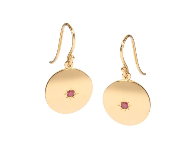 Yellow gold hook earrings with gold discs and two star-set rubies.