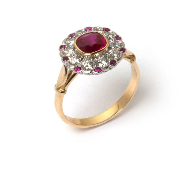 Antique-style ruby and diamond cluster ring in yellow and white gold.
