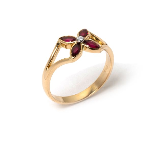 Four petal ruby and diamond yellow gold ring.