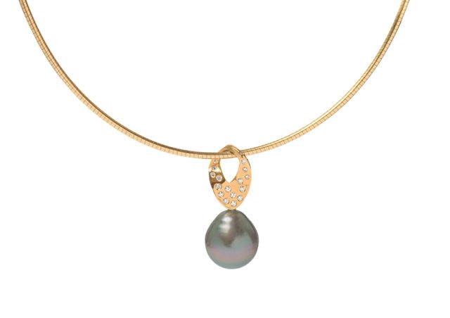 Tahitian pearl pendant with gyspy-set diamonds and yellow gold bail.