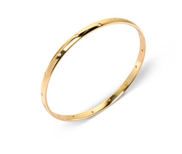 Yellow gold half-round bangle with gypsy-set diamonds.