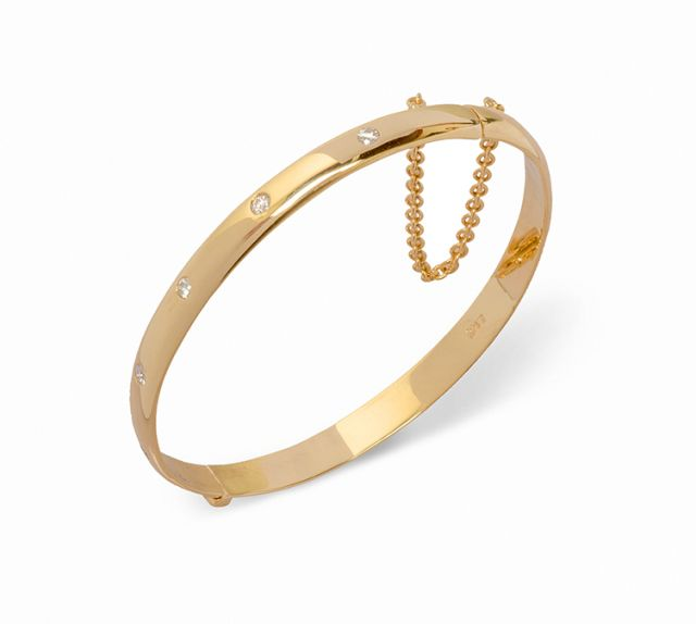 Yellow gold hinged bangle with gypsy-set diamonds.