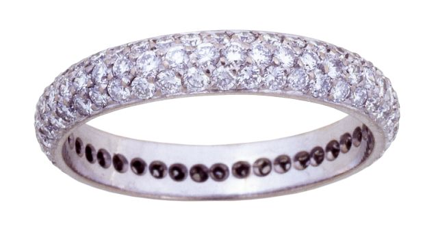 White gold band with diamonds pave-set full way round.