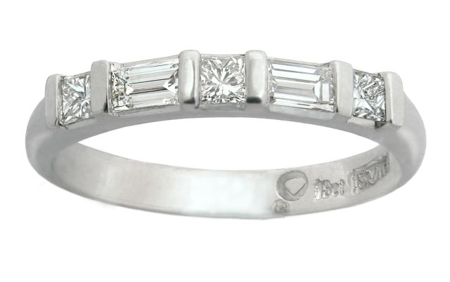 Alternating baguette and princess cut diamonds in a white gold band.