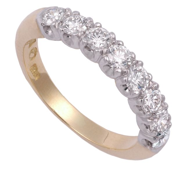Eight round Diamonds margo-set in white gold with yellow gold band.