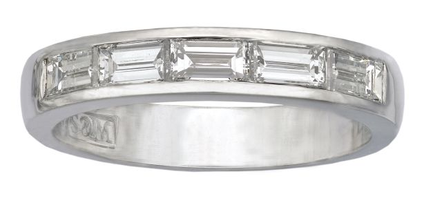 Baguette cut diamonds channel-set into white gold.
