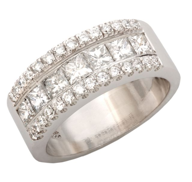 Princess cut diamonds channel-set with two rows of micro-set diamonds in a wide, white gold band.