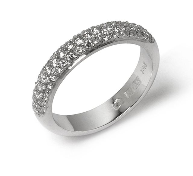 White gold band with diamonds pave-set halfway round.