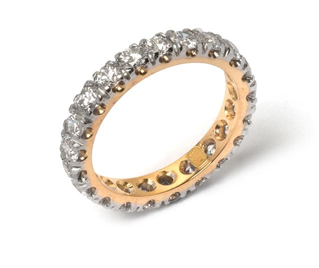 Yellow and white gold band with diamonds margo-set all-round.