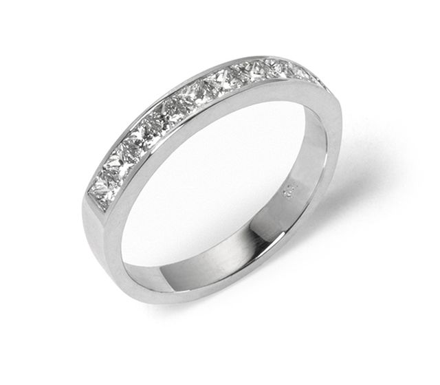 Princess cut diamonds channel-set into white gold band.