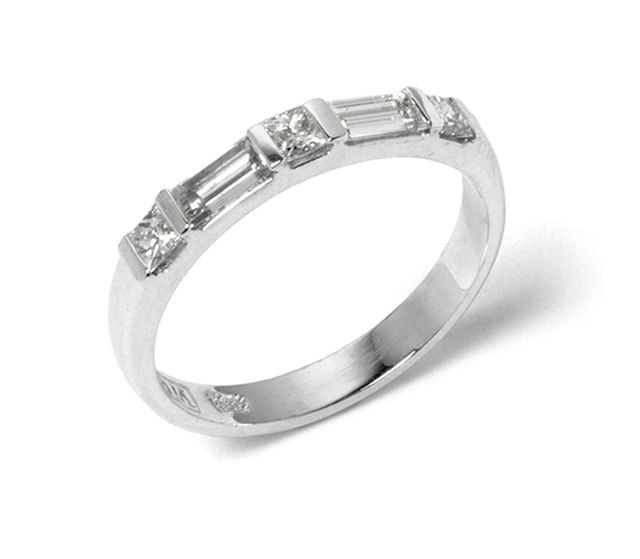 Alternating princess and baguette cut diamonds set into white gold.