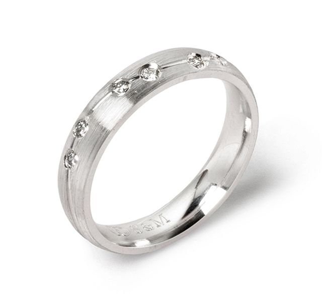 White gold band with diamonds swiss-set and carved line detail with satin finish.