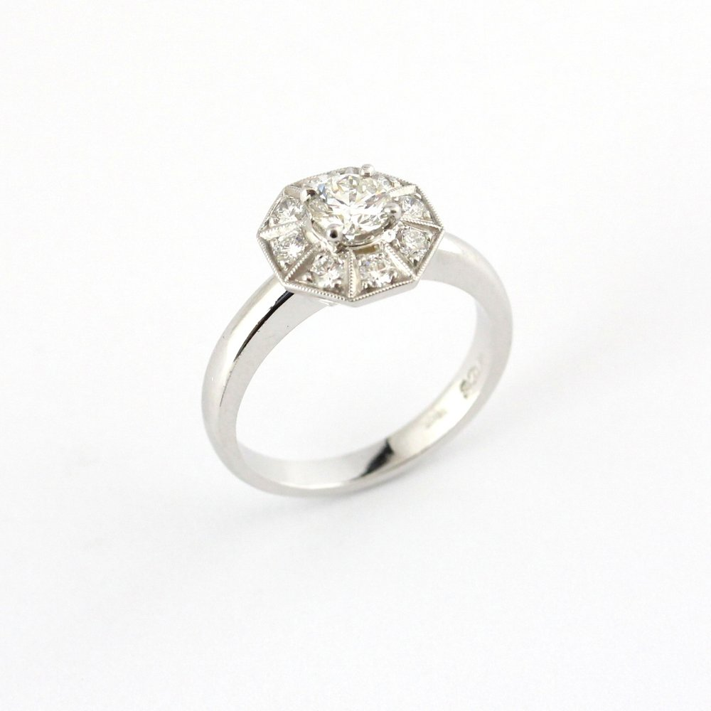 White gold octagonal diamond halo ring.