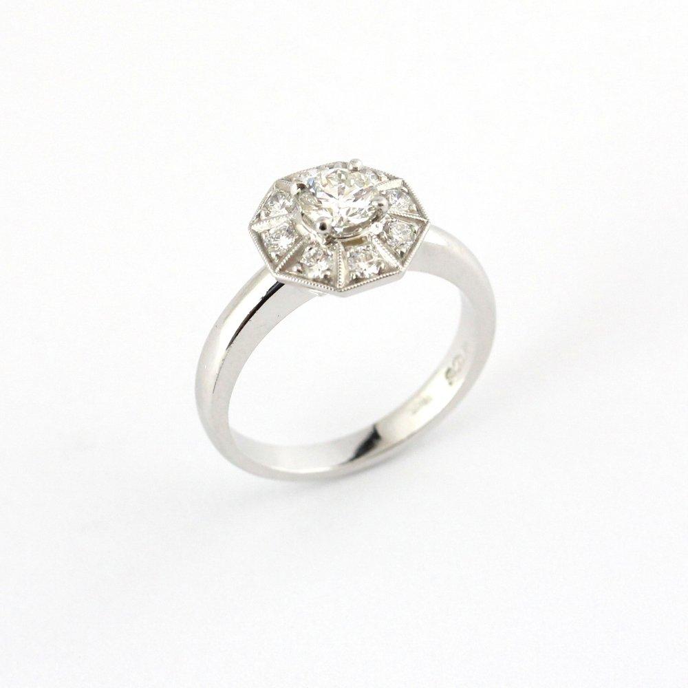 White gold octagonal diamond halo ring.