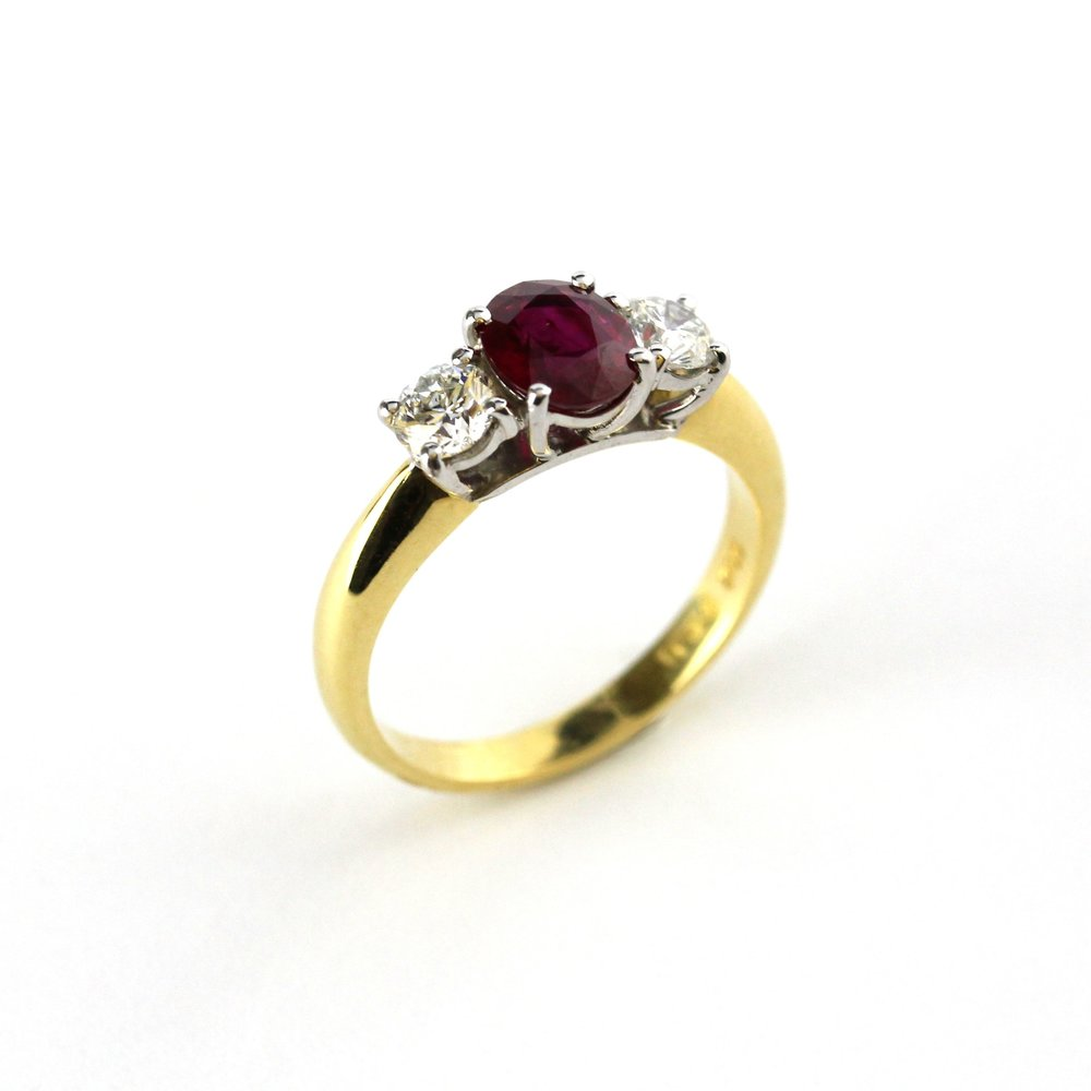 3 stone ruby and diamond set yellow and white gold ring.