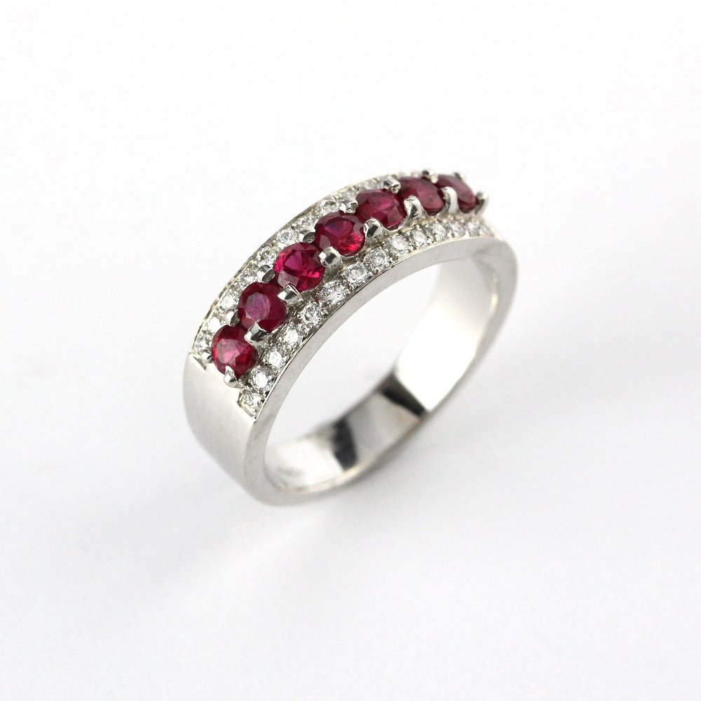 Rubies set in white gold ring with diamond rails.