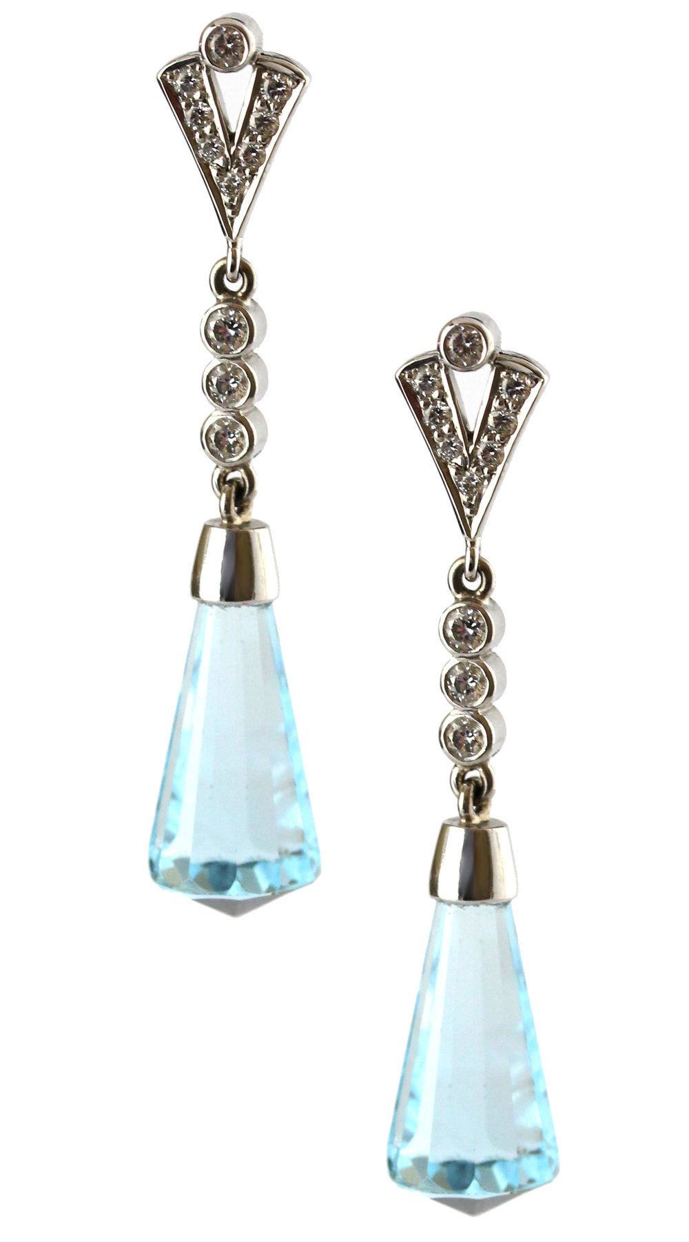 Blue topaz and diamond drop earrings in white gold.