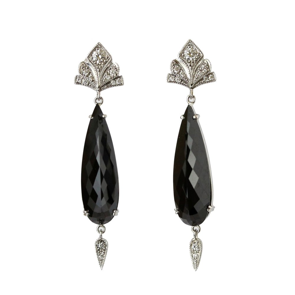 Black spinel faceted teardrop earrings with diamonds in white gold.