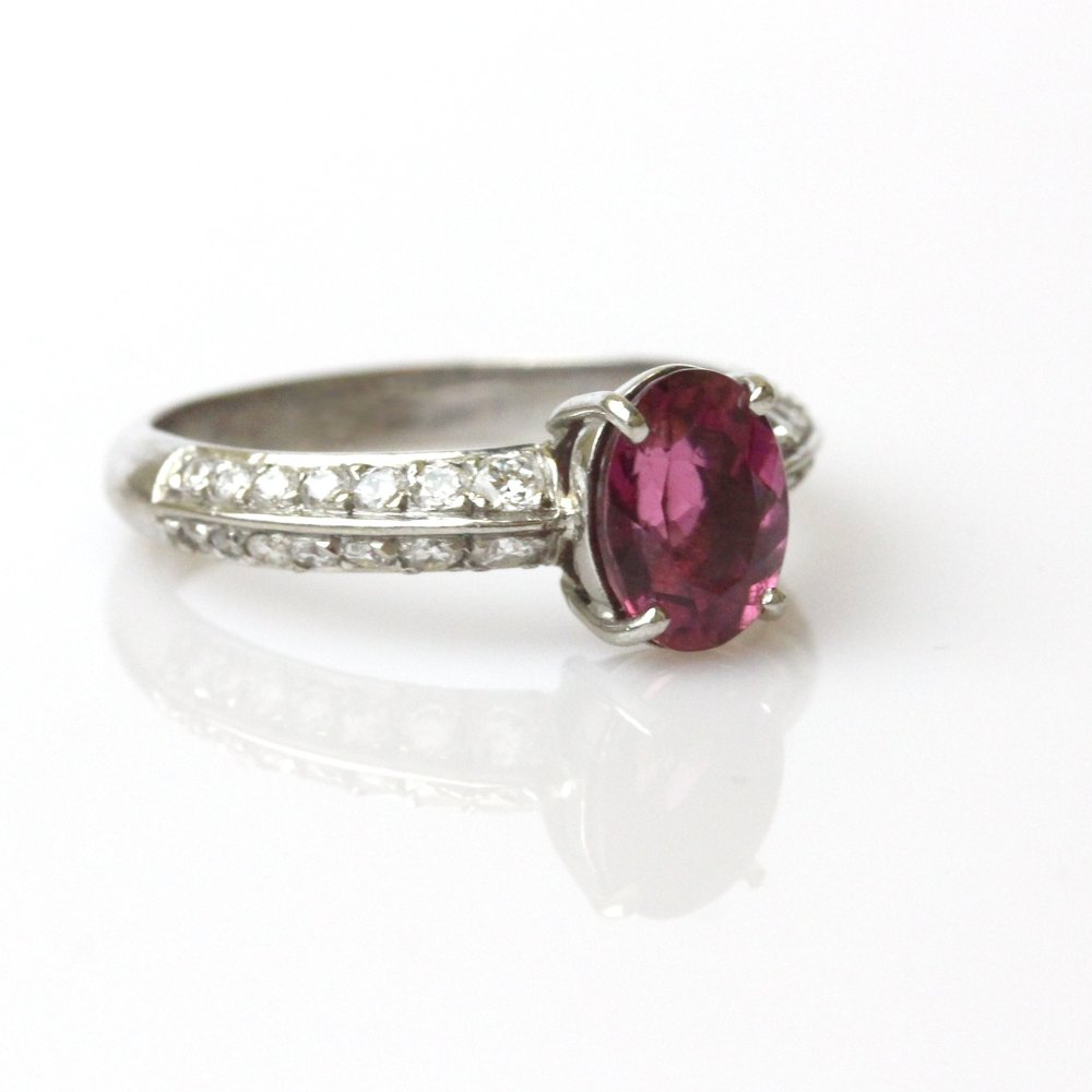 Pink tourmaline set in white gold ring with diamond shoulders.