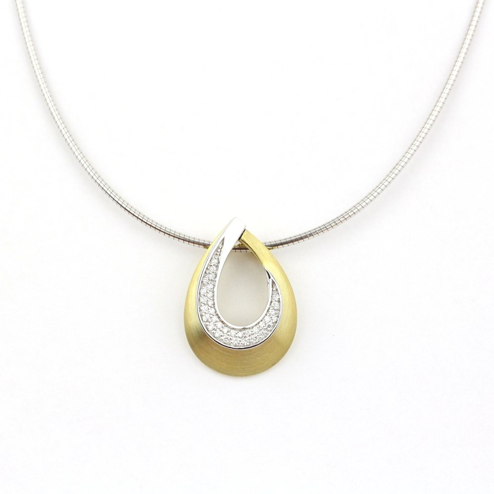 Diamonds set in white gold with brushed finish yellow gold.