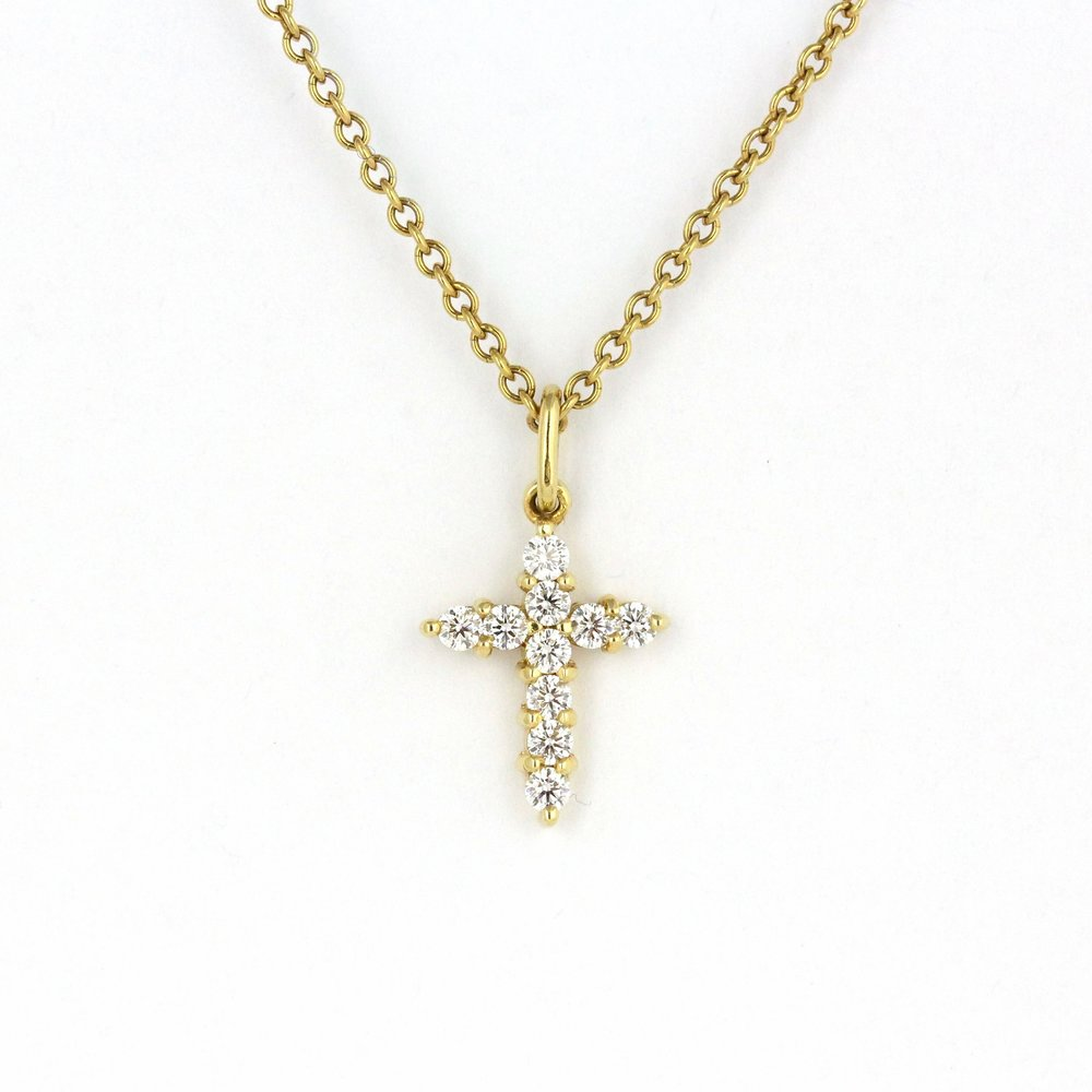 Yellow gold cross pendant set with diamonds.