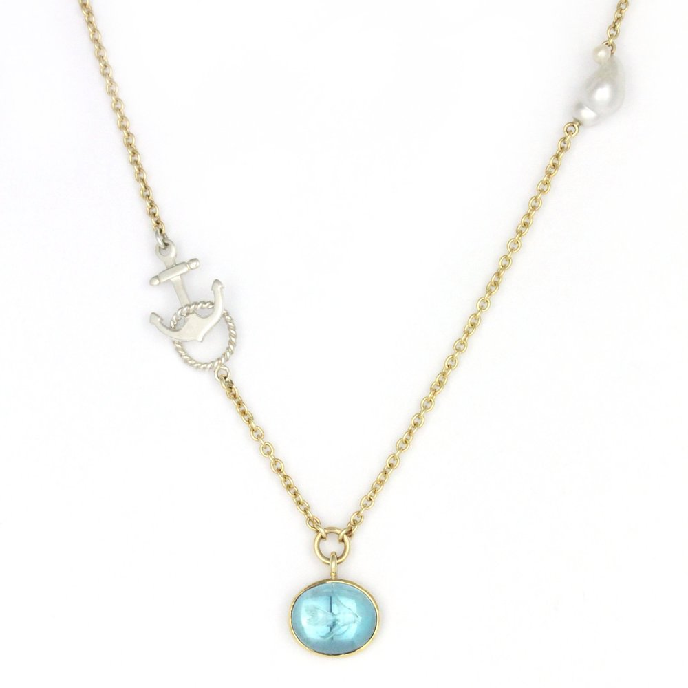 Goldfish engraved into cabochon blue topaz bezel set in yellow gold with a keshi pearl and sterling silver anchor and rope clasp.