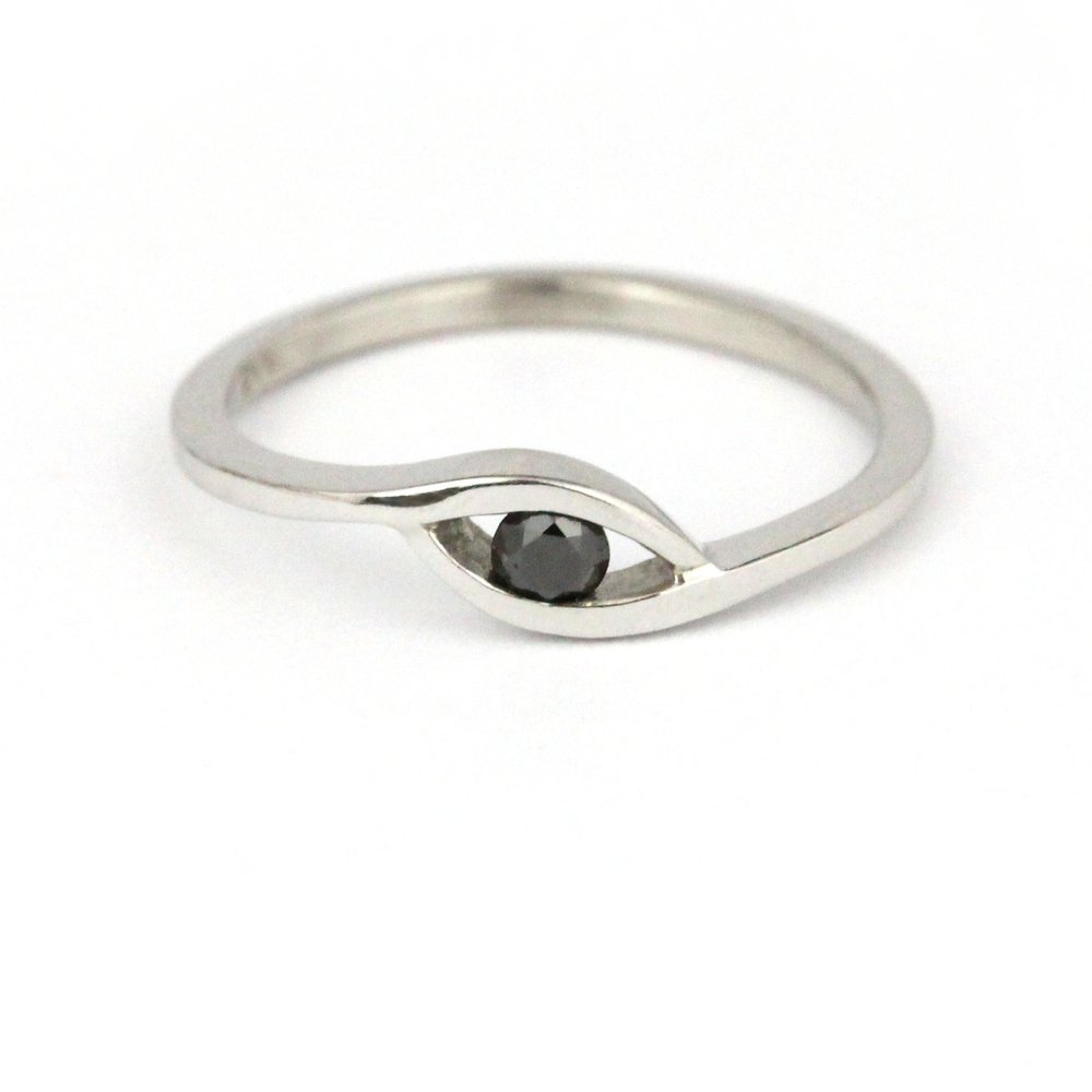 """Eye look"" black diamond set in white gold ring."