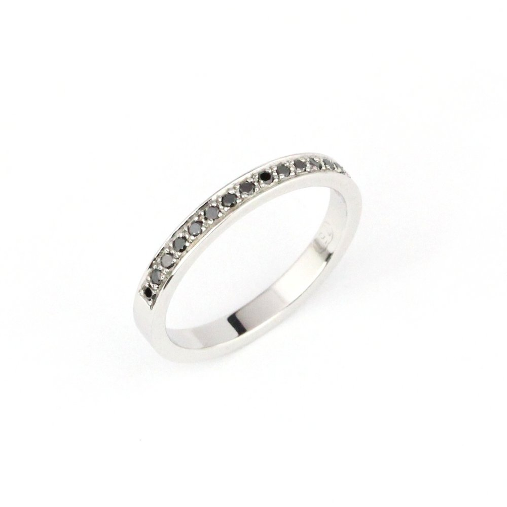 Black diamonds grain set into white gold ring.