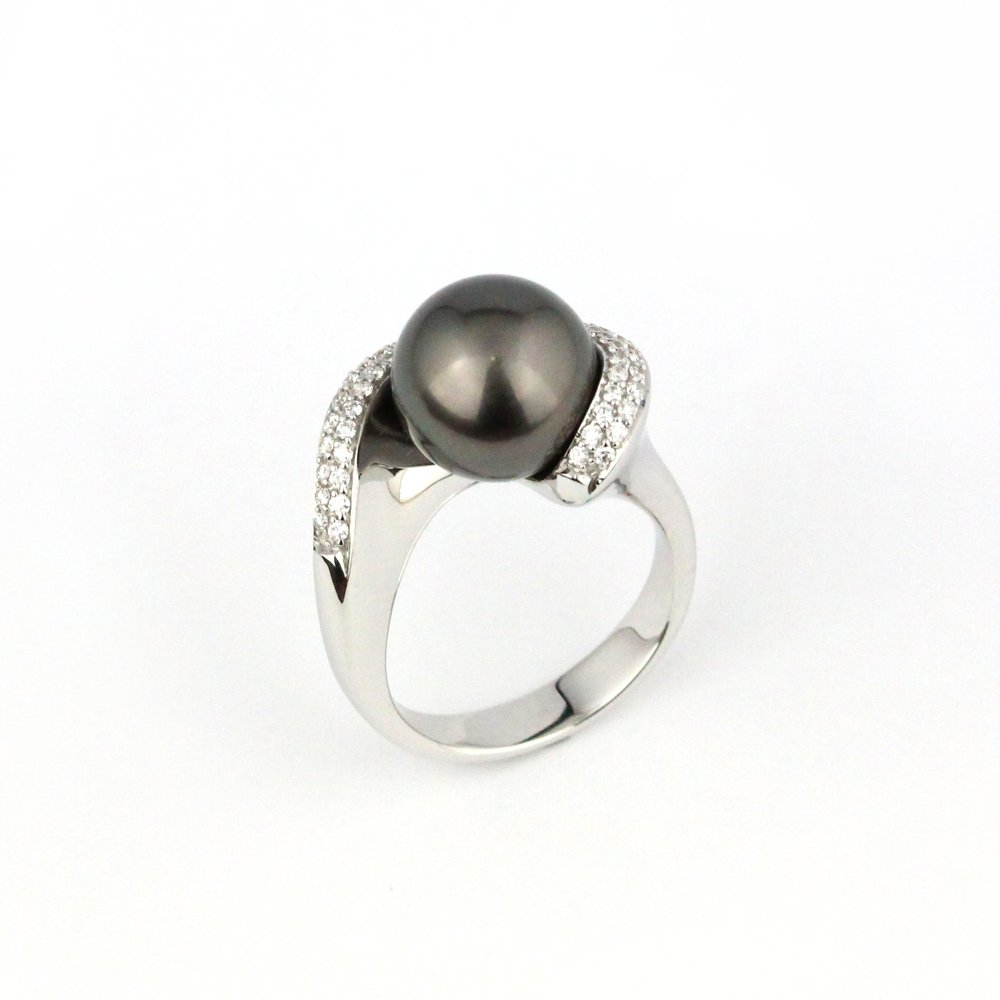 Tahitian pearl white gold ring set with diamonds.
