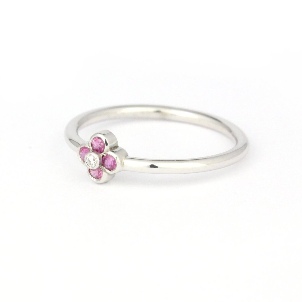 Pink sapphires and diamond white gold flower ring.