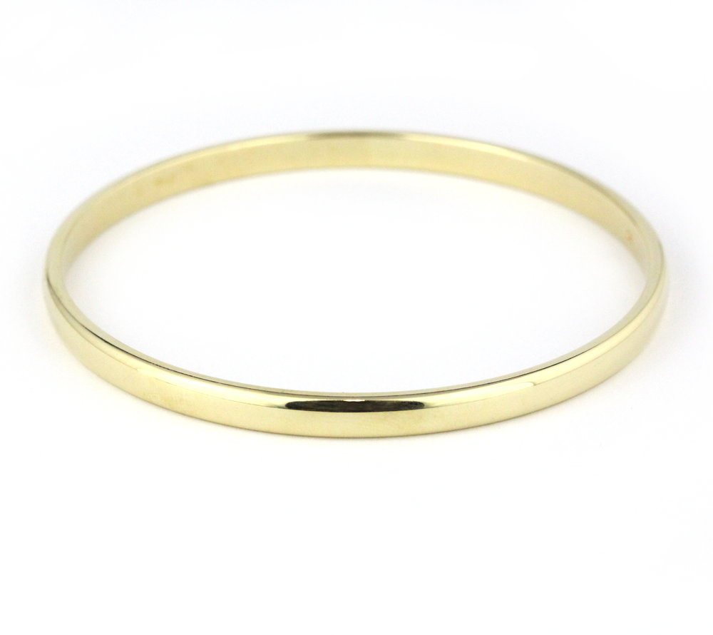Thick yellow gold half round bangle.
