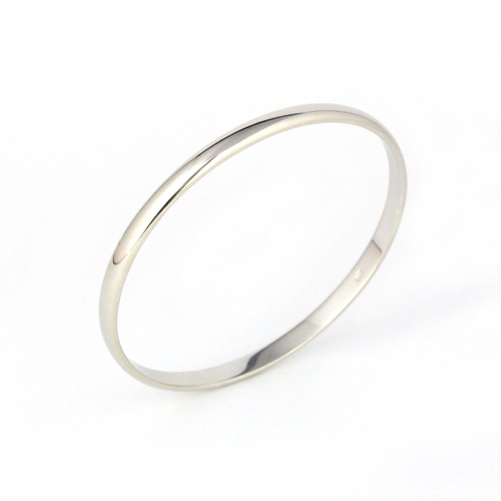 Thick white gold half round bangle.